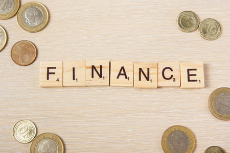 cents: Finance. Money dollars euro cents on wooden table desk background with copy space for ad text. Stock Photo