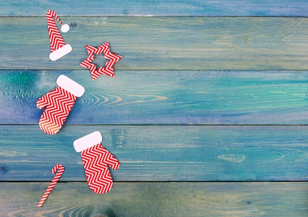 Christmas present box decoration over blue wooden background, above view