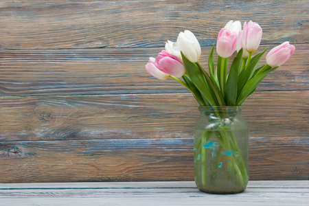 Beautiful pink flowers tulips on wooden table. Top view with copy space. Stock Photo