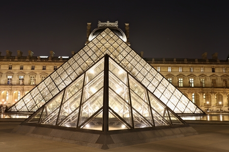 Louvre pyramid museum in Paris at night light, Musee du Louvre.