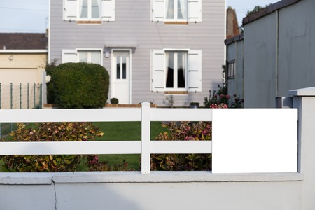 Real estate concept. Custom made luxury house at summer, fall, autumn season, time with nicely landscaped and trimmed front yard in the suburbs of Dieppe, France Copy space