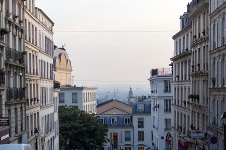 Montmartre streets in Paris, France, Europe. Cozy cityscape of architecture and landmarks. Travel sightseeng concept