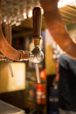 Beer bar pub tap, counter with blur pub background. Brussel Belgium