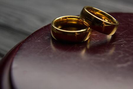 Divorce and separation concept. Two golden wedding rings, judge gavel. Stock Photo