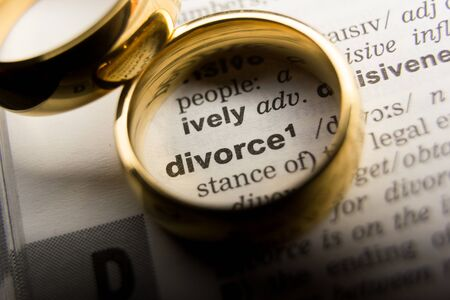 Divorce and separation concept. Two golden wedding rings. Dictionary definition Stock Photo