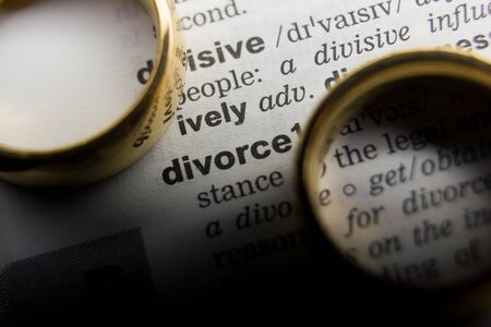 Divorce and separation concept. Two golden wedding rings. Dictionary definition 写真素材