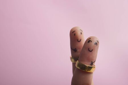 Painted happy family fingers smiley in love with marriage wedding rings.