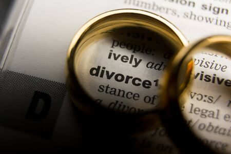 Divorce and separation concept. Two golden wedding rings. Dictionary definition Фото со стока