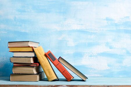 Books on wooden desk table and abstract background. Education background. Copy Space. Back to school