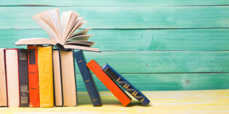 Books on wooden desk table and abstract background. Education background. Copy Space. Back to school.