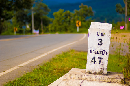 kilometer: Kilometer marker to Pai in landscape view Stock Photo