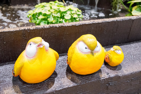 doublet: couple yellow birds ceramic for garden and home decoration