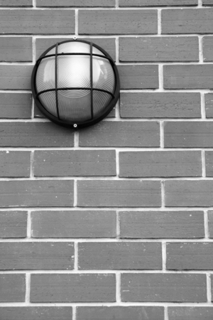glass partition: glass lantern on the brick wall in grayscale mode