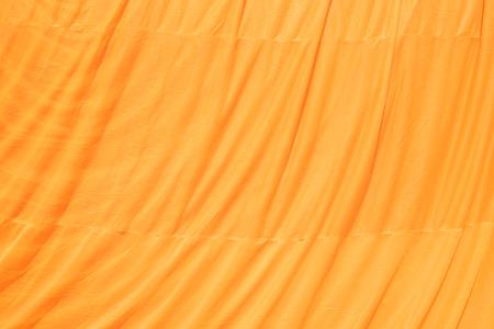 Robe: yellow robe of Buddhist monk pattern background