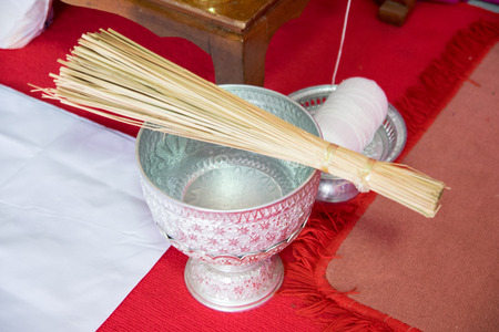 consecrated: Thai holy water in water dipper Stock Photo