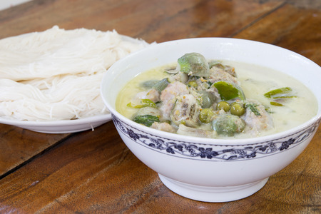 hectic: Thai green curry and Thai vermicelli on old table background Stock Photo