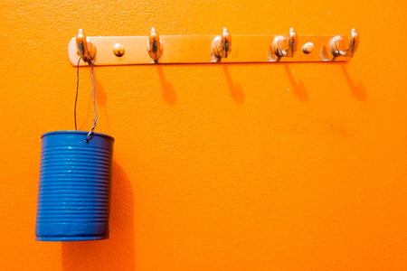 hung: Colorful can be hung on colorful cement wall