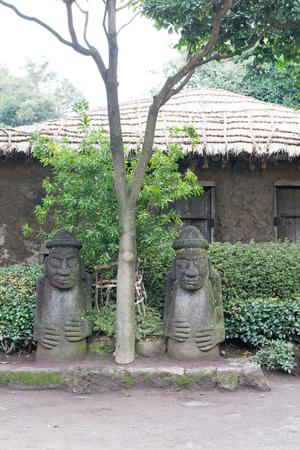 ism: statue of Dol hareubang god at Jeju island