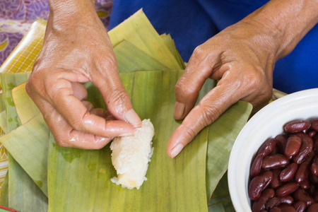 tenacious: steamed sticky rice with banana wrapped in banana leaves