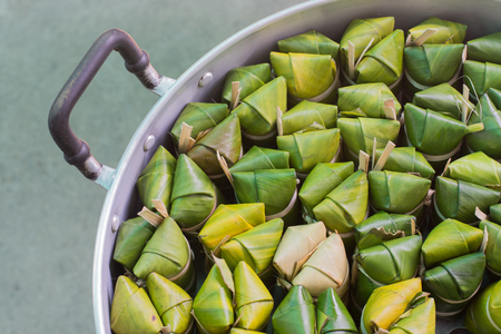 cohesive: steamed sticky rice with banana wrapped in banana leaves