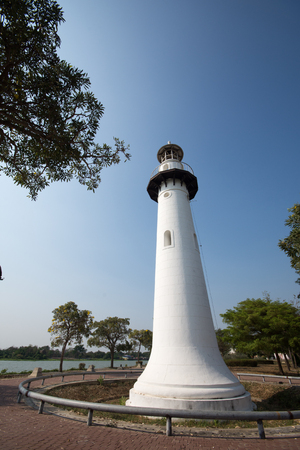 old white lighthouse on the island in the middle river. Ayutthaya, Thailand.
