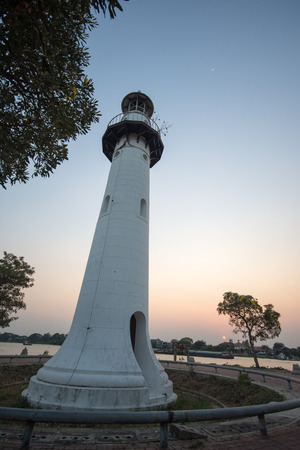 White lighthouse on the island in the middle river. Ayutthaya, Thailand. Stock Photo