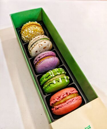A box of colourful macarons desserts