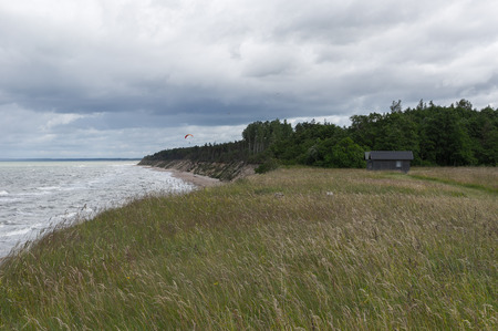 Baltic sea cliff with Paraplane in the summer, windy weather. day cloudy photo