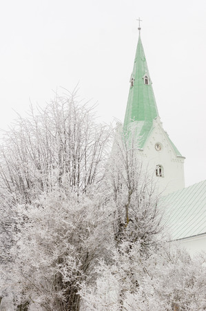 without window: Church Park in winter, snowing. Snow-covered trees. Stock Photo
