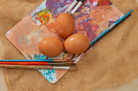 insulated: Painting Easter eggs: Brush on colors with eggs in the background. The color palette