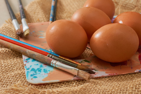 quadratic: Painting Easter eggs: Brush on colors with eggs in the background. The color palette