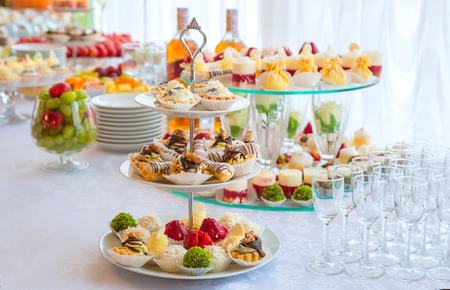 Authentic buffet, assorted fresh fruits, berries and citrus fruits. Morning atmospheric lighting, fashionable trendy spot soft focus. Preparation for design creative menu. Stock Photo