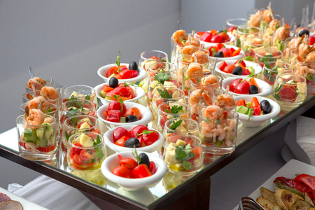 Banquet Table in restaurant served with different meals. Ready for wedding reception. Stockfoto