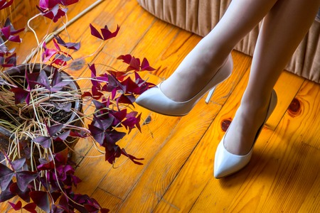 Shoes on the feet of the bride