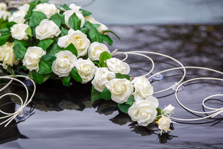 Beautiful flowers decoration on wedding car bonnet. White flowers on the hood of car
