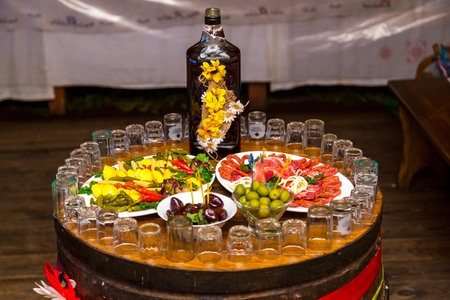 Cossack table. Ukrainian and Russian traditions. Snack for vodka and wrote on a wooden barrel.