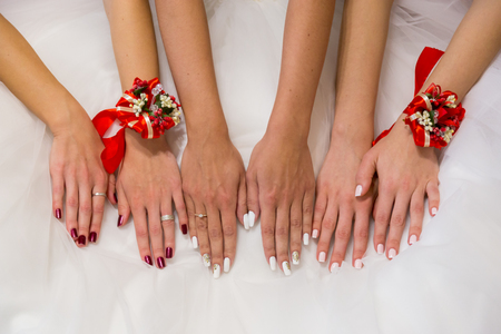 Closeup hands of the bride and bridesmaids.