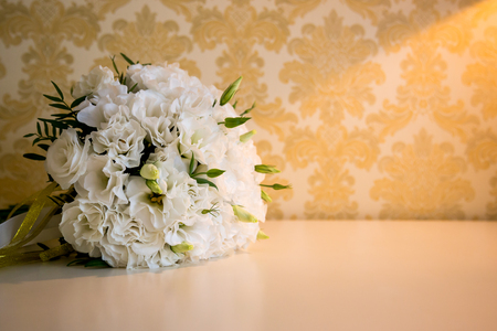 White wedding bride bouquet on the table