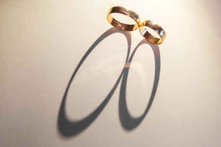 Background of wedding rings. The light passes through the wedding rings and forms a shadow.