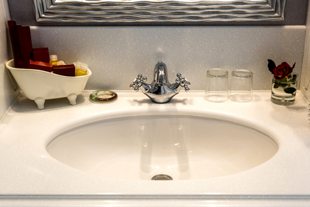 Sink Hotel Bathroom. Classical Washbasins. Morning in the hotel Stock Photo