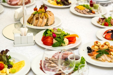 Banquet Table in restaurant served with different meals.