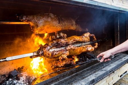 Pig on a grill. traditional coal and fire
