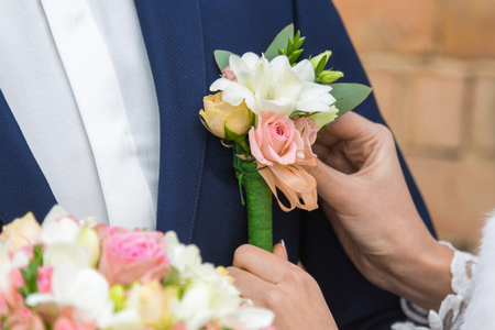 the bride holding the wedding bouquet