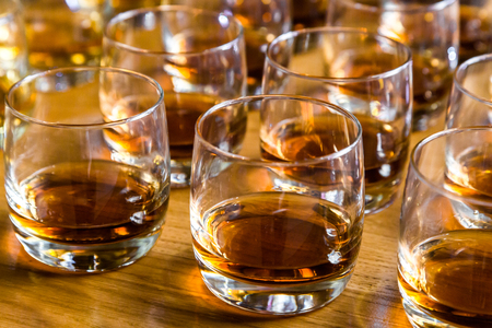 Glasses are filled with whiskey on the table Foto de archivo