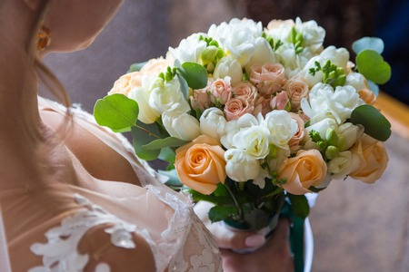 wedding bouquet bride behind. Bride holds beautiful.