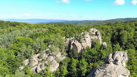 Aerial. Great relief of rocks among the thick green forest in th