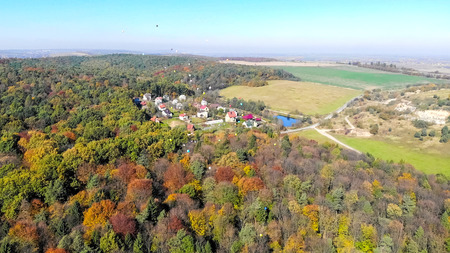 Colorful helium balloons fly into the sky. Aerial view.