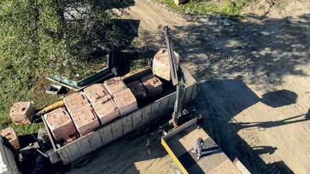 UKRAINE LVIV December 29th 2018. Aerial view the truck unloads t
