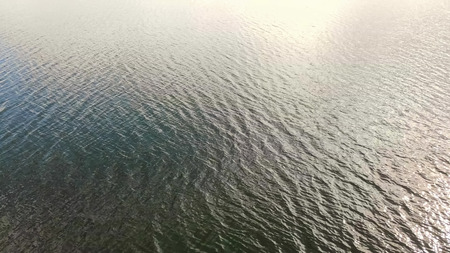 Aerial Top view of the water texture from the altitude. The wave