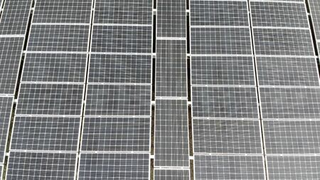 Aerial view Panorama of solar panels. Slow movement of the camera over the panels. Background